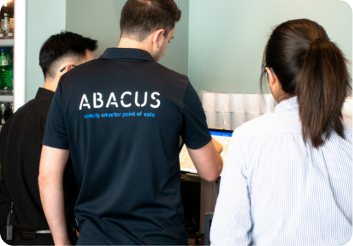 abacus team setting up POS system at a restaurant