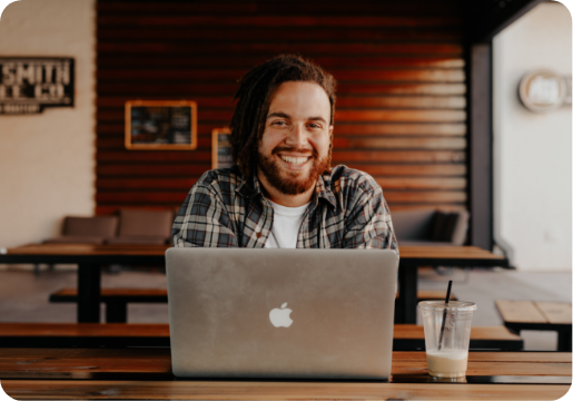 young happy man on laptop