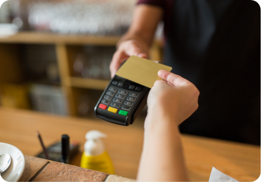 customer tapping card at payment terminal